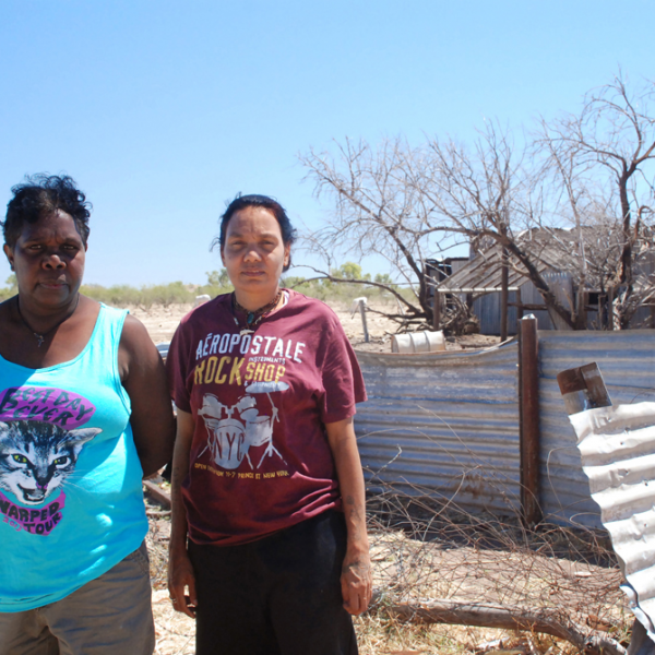 Serena Donald Narrpingali Nimarra and her niece Leah Leaman Namija, near old cookhouse, Jinparrak (Old Wave Hill Station), 26 August 2014