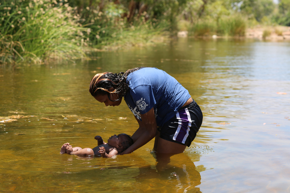 Diandra with her niece, Teniquah, 'Families Are First Teachers' Life-saving program session, Lawi, Wattie Creek, 21 October 2015