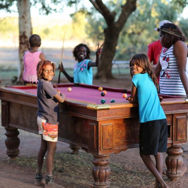 Girls playing outdoor pool, Kalkaringi, 7 July 2015